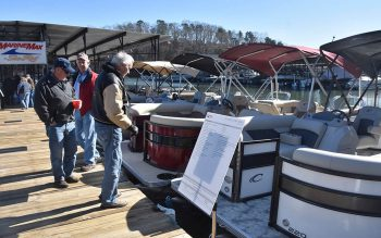 Attendees check out boats during in-the-water boat show at MarineMax
