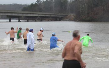 Swimmers symbolically run away from 2020 at the annual Polar Bear Plunge at LLOP