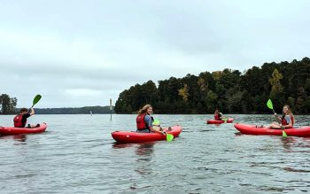 Burton Outdoor Adventures customers paddle on the south end of Lake Lanier.