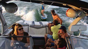Jenny Serwitz driving boat on Lake Lanier