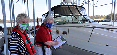 Nan Ellen Fuller conducts vessel safety check for boater Connie Gannaway