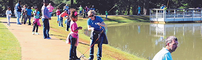 Families fishing at the Go Fish Education Center