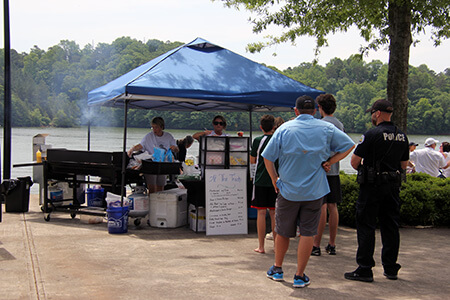 Lake Fest attendees wait in line for food from food truck