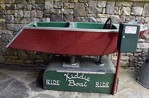 Old boat ride toy for children - it still costs a dime to ride it.