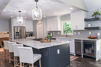 Example of a kitchen remodel with white cabinets and blue accent colors - 2021 trends