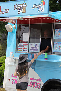Lake Fest attendee ordering smoothie.