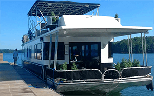 """houseboat """"Song of the Chattahoochee"""" tied to dock"""