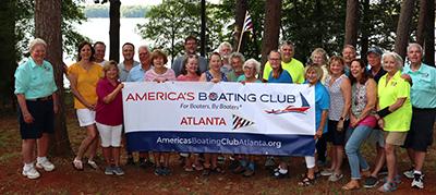 America's Boating Club Atlanta group photo holding ABC sign
