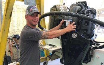 Mike Allen, owner of Quality Marine, with Mercury motor