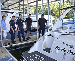 Hall County fire fighters tour docks at University Yacht Club on Lake Lanier