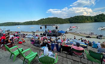 Beach Bash at LLOP people watching band play with Lake Lanier in background
