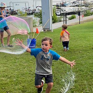 Bursting giant bubbles during last month's Beach Bash at Lake Lanier Olympic Park