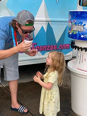 Young girl waits to get her frozen treat