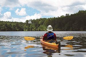View of Kayaker paddling away