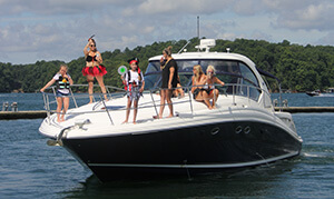 Family on front of motor boat as they come in for stop during Poker Run