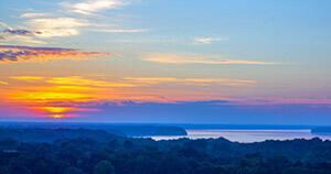 Orange sunrise over the pretty blue colors of Lake Wilson