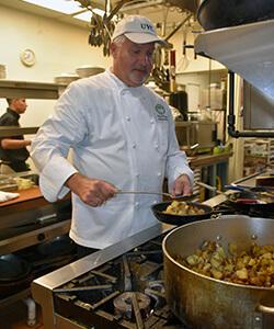 Chef Rudy preparing food in the UYC kitchen