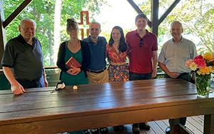 Frank Bulloch family members standing behind a table in Bulloch Chapel