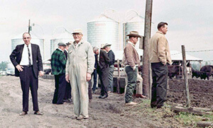 1967 photo with cattle and silos in background