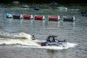 spectators watch wakeboarder from boats on the lake