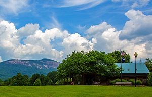 Blue sky, white clouds, Table Rock Mountain in backgroundck Mountain