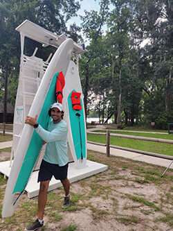 Man carrying stand up board
