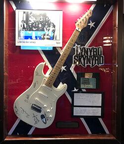 Guitar in display case from Lynyrd Skynyrd band