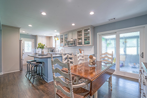 Kitchen remodel with large windows and light cabinets